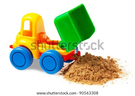 Colorful toy truck with sand over white background