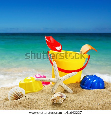 colorful toys for childrens sandboxes against the sea and the beach