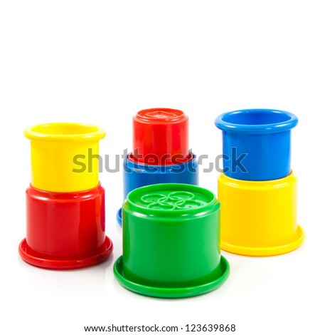Colorful toys for kids. colorful plastic cups on the white background