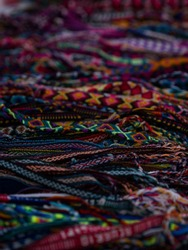 Colorful traditional andean indigenous handmade woven bracelet textiles Otavalo handicraft market Ecuador South America