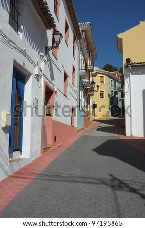 Colorful traditional architecture against blue sky, a Mediterranean village street