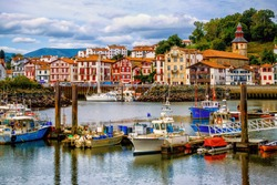 Colorful traditional basque houses in port of Saint-Jean-de-Luz Old Town, France