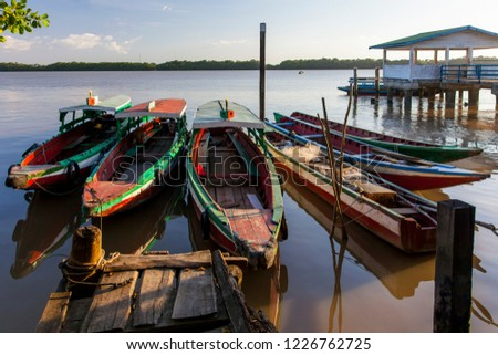 Colorful traditional boats on the Suriname river, Suriname #1226762725
