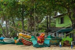 Colorful traditional fishing boat on the beach, Arugam Bay, Sri Lanka