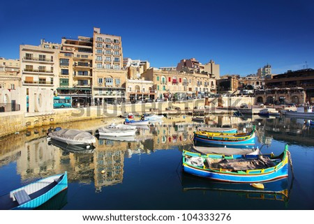 Colorful, traditional fishing boats in the mediterranean island of Malta.