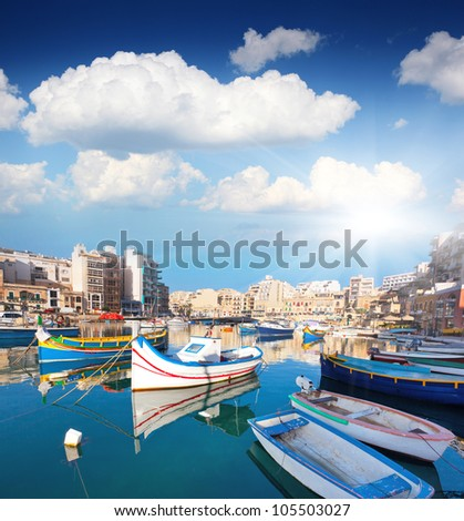 Colorful traditional fishing boats in the mediterranean island of Malta.