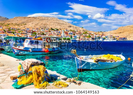 Colorful traditional Greece - beautiful island Chalki with fishing boats
