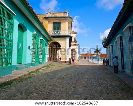 Colorful traditional houses and cobblestones street in the colonial town of Trinidad in Cuba