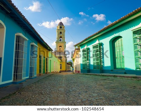 Colorful traditional houses and old church in the colonial town of Trinidad in Cuba