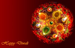 Colorful traditional Indian clay lamps lit on rangoli design along with floral decorations with rose petals for Diwali festival background content.