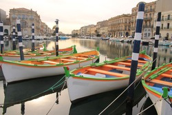 Colorful traditional wooden boats in Sete, a seaside resort and singular island in the Mediterranean sea, it is named the Venice of Languedoc Rousillon, France