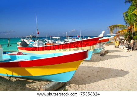 colorful tropical boats beached in the sand Isla Mujeres Mexico