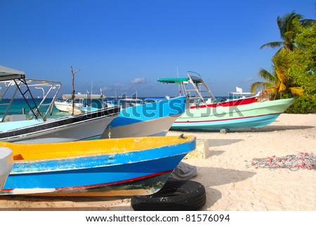 colorful tropical boats beached in the sand of Isla Mujeres Mexico