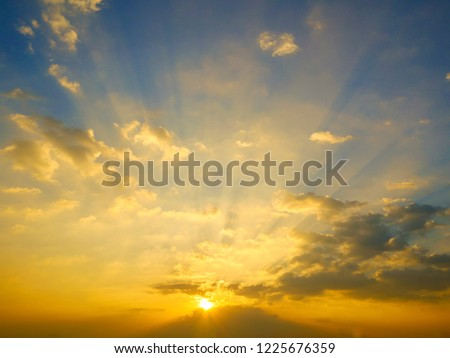 Colorful twilight sky background. abstract sun beam line light shining through the clouds. Sunbeam through the clouds haze on Beautiful sky #1225676359