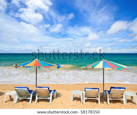 Colorful Umbrella and chair on the beach in Summer at Phuket Thailand