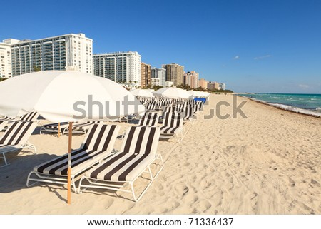 Colorful umbrellas and lounge chairs on Miami's South Beach.