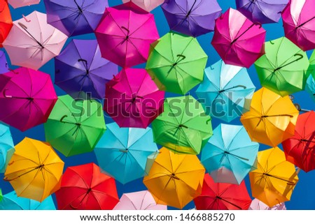 Colorful umbrellas background. Colorful umbrellas in the sky #1466885270