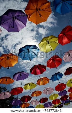 Colorful Umbrellas background. Colorful umbrellas in the sky #743773843