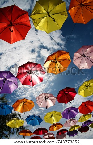 Colorful Umbrellas background. Colorful umbrellas in the sky #743773852