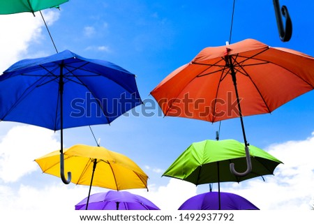 Colorful umbrellas background. Colorful umbrellas in the sky.decoration. #1492937792