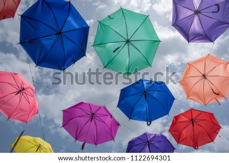 Colorful umbrellas background. Colorful umbrellas in the sky. Street decoration. #1122694301