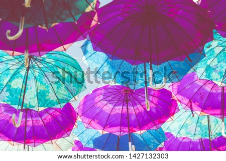 Colorful umbrellas background. Colorful umbrellas in the sky. Street decoration. #1427132303