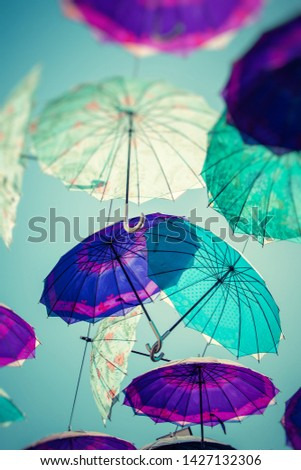 Colorful umbrellas background. Colorful umbrellas in the sky. Street decoration. #1427132306