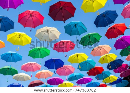 Colorful umbrellas background. Colorful umbrellas in the sky. Street decoration. #747383782