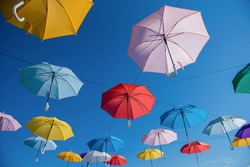 Colorful umbrellas background. Colorful umbrellas in the sky. Street decoration. Conceptual art composition.