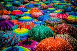Colorful umbrellas interior top view. Cool rain umbrellas for beach cover background. Blue,Green,Red, Rainbow umbrellas. Summer umbrella Rain protection- cute cover from shower and autumn weather.