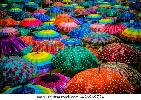 Colorful umbrellas interior. Umbrella top view. Cool umbrellas. Rain umbrella. Beach cover. Blue umbrella Green Red. Cute cover shower. Umbrella summer. Autumn weather. Rain protection. Rainbow color