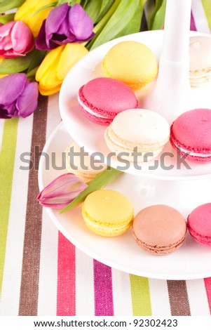 Colorful variety macaroons with tulips bouquet