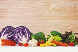 colorful vegetables and wood background