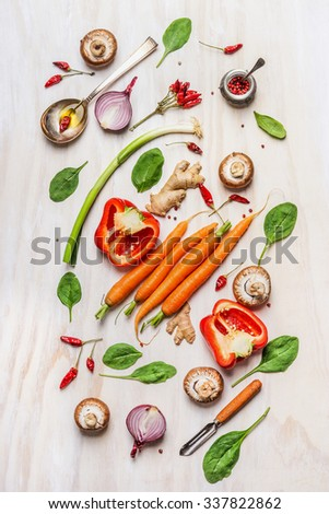 Colorful vegetables ingredients for healthy cooking. Composing on white wooden background. Vegan nutrition and diet food concept. Top view