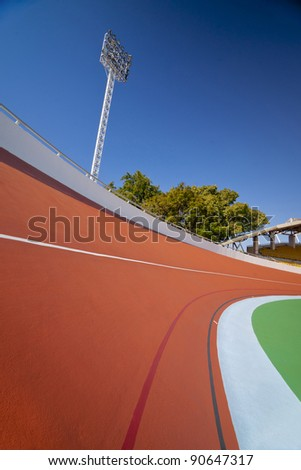 colorful velodrome curve and spot light in blue sky day