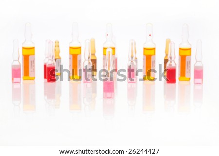 colorful vials against white background