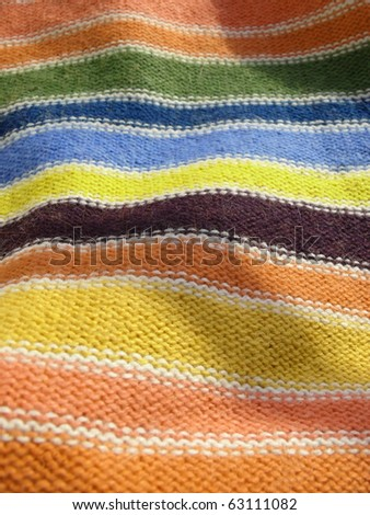 Colorful vibrant stripy mohair woolen textile texture close up. More of this motif & more textiles in my port.