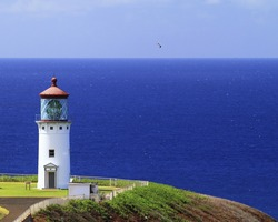 Colorful view of the Kilauea Point Lighthouse and the deep blue ocean off the north shore of Kauai, Hawaii.