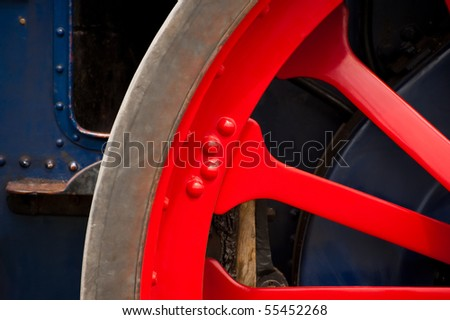 colorful vintage steam traction engine wheel detail