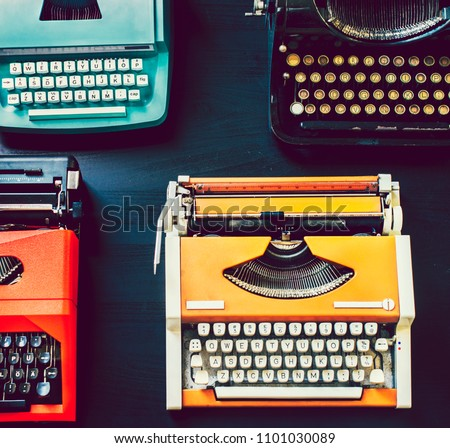 Colorful vintage typewriters on a table