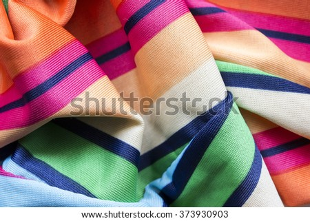 Colorful viscose cloth draped as a background #373930903