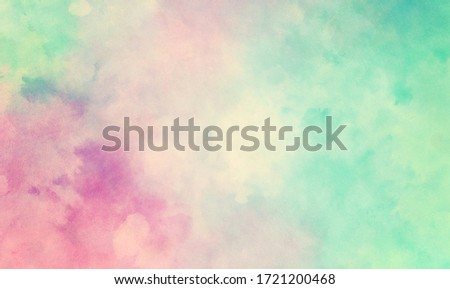 Colorful watercolor background of abstract sunset sky with puffy clouds in bright painted colors of pink blue green and white