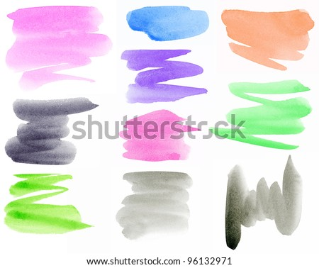 Colorful watercolor hand painted brush strokes are isolated on a white background.