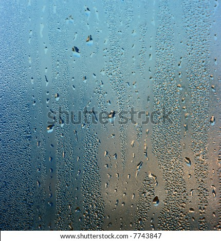 Colorful waterdrops on the window