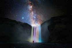 Colorful waterfall with milky way