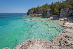 Colorful Waters on a Secluded Indian Cove on Lkae Huron in Bruce Peninsula National Pqrk in Ontario