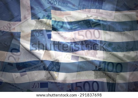 colorful waving greek flag on a euro money background