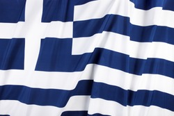 Colorful, wavy flag of Greece fills the frame
