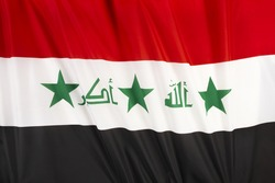 colorful, wavy flag of Iraq fills the frame