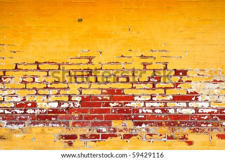 Colorful weather worn yellow, and red brick wall
